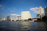 Chao Praya River. View from shuttle boat of Oriental Hotel. Oriental l. small), Shangri-la (m.), State Tower (r.)