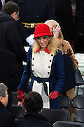 Presidential advisor Kellyanne Conway wears a red hat and Gucci wool A-line coat as she arrives for the Inaugural Ceremony on Capitol Hill January 20, 2017 in Washington, DC. Donald Trump was sworn-in as the 45th President of the United States.