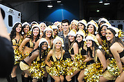 Twilight ACTOR TAYLOR LATNER hangs out on the Saints sidelines and poses with Saints owner Rita Benson Leblanc AND THE SAINTSATIONS cheerleaders in the tunnel  prior to the kick off against the St. Louis Rams.The New Orleans Saints play the St. Louis Rams in New Orleans at the Super Dome Sunday Dec. 12,2010.  SAints were winning 21-6 at half time.Photo©SuziAltman. New Orleans, Louisiana, U.S. - Twilight Actor TAYLOR LAUTNER hangs out on the Saints sidelines prior to the kick off against the St. Louis Ram.The New Orleans Saints play the St. Louis rams in New Orleans at the Super Dome Sunday Dec. 12,2010. Saints went on to win 31-13..(Credit Image: © Suzi Singer and actress MILEY CYRUS poses for a fan's camera phone with New Orleans police officers on the sidelines prior to The New Orleans Saints' kickoff against the St. Louis Rams at the Superdome. Cyrus is currently filming ''So Undercover'' in New Orleans.Photo©Suzi Altman