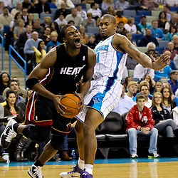 November 5, 2010; New Orleans, LA, USA; Miami Heat power forward Chris Bosh (1) drives past New Orleans Hornets power forward David West (30) during a game at the New Orleans Arena. The Hornets defeated the Heat 96-93. Mandatory Credit: Derick E. Hingle