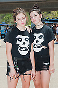 """SAN DIEGO, CA - Tiger Slavin and her girlfriend Adrianne Drewniak came from Las Vegas and wore matching Misfits shirts at the Vans Warped Tour's stop in San Diego, California, June 22, 2018. <br /> <br /> Adrianne has attended the Warped Tour every year since 2012. <br /> <br /> """"With the punk community, everyone acts like they're already your friends, Adrianne Drewniak said. In the mosh pit, """"if you fall people will pick you up. If you're tying your shoe, people will form a wall around you. The bands will come down into the crowd. They don't act like they're too good for you."""""""