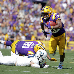 Oct 5, 2019; Baton Rouge, LA, USA; LSU Tigers running back Clyde Edwards-Helaire (22) runs against the Utah State Aggies during the first half at Tiger Stadium. Mandatory Credit: Derick E. Hingle-USA TODAY Sports