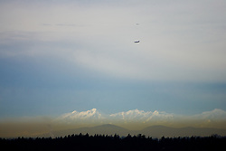 North America, United States, Washington, Olympic Mountains viewed from Bellevue on a smoggy day.