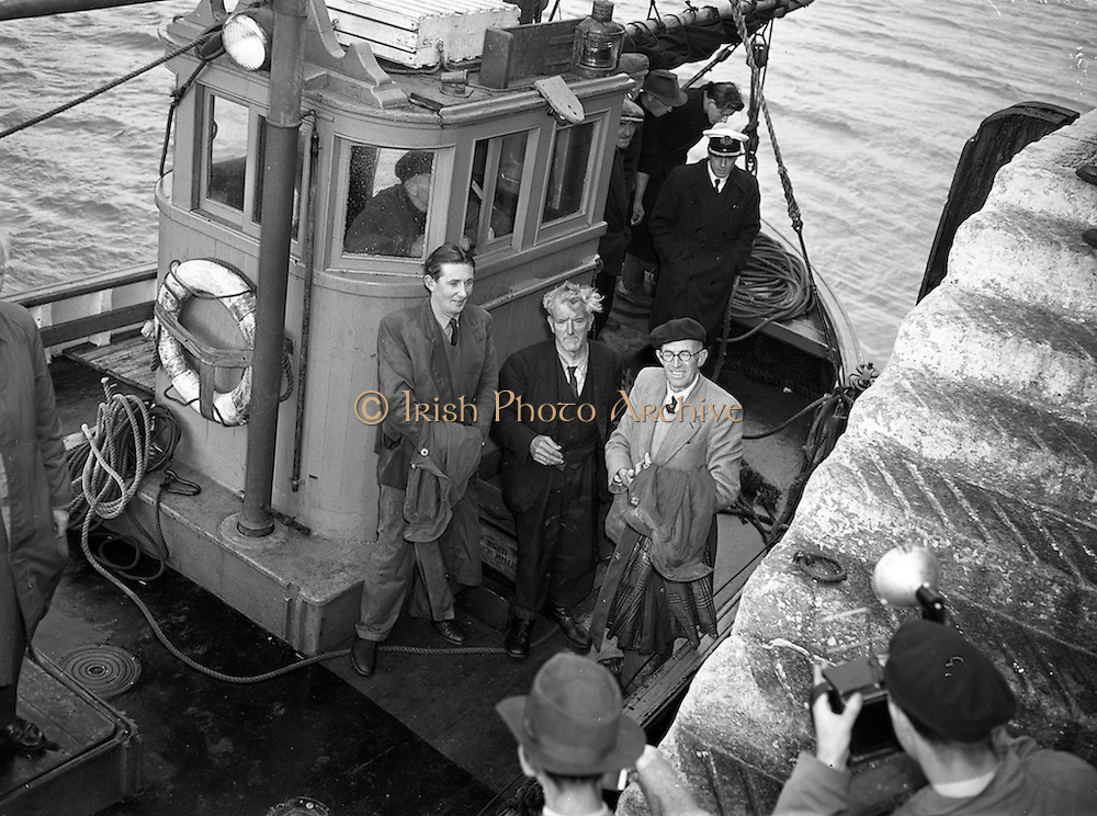 """31/08/1953<br /> 08/31/1953<br /> 31 August 1953 <br /> Rescue at sea by  50 foot trawler """"Uncle Pat"""" of three Co. Dublin men who spent a night in a row boat at Dun Laoghaire.  The three men pose for the cameras before stepping ashore."""