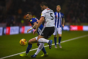Steven Fletcher of Sheffield Wednesday (9) and Jack O'Connell of Sheffield United (5) come together to try win the loose ball during the EFL Sky Bet Championship match between Sheffield United and Sheffield Wednesday at Bramall Lane, Sheffield, England on 9 November 2018.