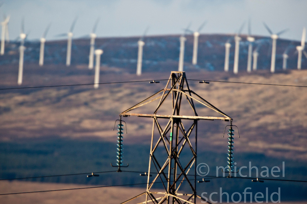 Windfarm behind a pylon. View from the slope of the Dumyat, a hill at the western extremity of the Ochil Hills, in central Scotland..Pic © Michael Schofield...