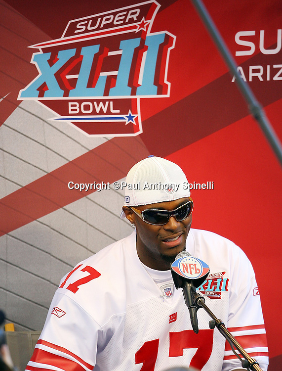GLENDALE, AZ - JANUARY 29: Wide receiver Plaxico Burress #17 of the New York Giants grins as he speaks to the media at the Giants Super Bowl XLII Media Day at University of Phoenix Stadium on January 29, 2008 in Glendale, Arizona.©Paul Anthony Spinelli *** Local Caption *** Plaxico Burress