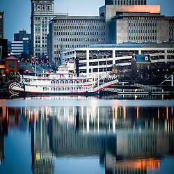 Picture of Peoria Illinois cityscape with the Spirit of Peoria riverboat and downtown city buildings.