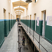 A corridor of the original prison at the Maritime Museum of Ushuaia. The museum consists of several wings devoted to maritime history, Antarctic exploration, an art gallery, and a policy and penitentiary museum. The complex is housed in an historic prison building and uses the original cells and offices as exhibit spaces.