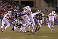 Kansas State's John McCardle (28) blocks Greg Johnson's (97) punt of Texas, in the third quarter at Bill Snyder Family Stadium in Manhattan, Kansas, November 11, 2006.  The Wildcats upset the 4th ranked Longhorns 45-42.<br />