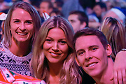 Saracens and Wales International Rugby player Liam Williams, girlfriend and model Sophie Harries (centre) and friend (left) during the PDC William Hill World Darts Championship at Alexandra Palace, London, United Kingdom on 21 December 2019.
