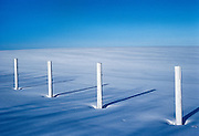 Fence and snow<br /> Tofield<br /> Alberta<br /> Canada