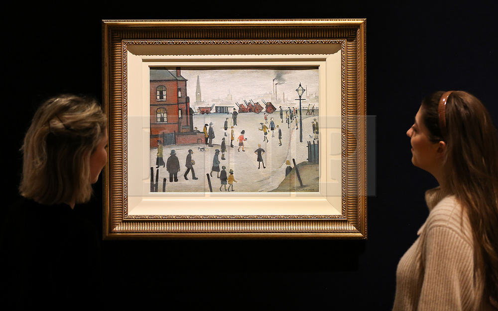 "© Licensed to London News Pictures. 12/11/2018. London, UK. Staff members looks at ""Rounders"" oil on panel by Laurence Stephen Lowry R.A. (British, 1887-1976). (Estimate £400,000-600,000).<br /> Bonhams Modern British and Irish Art photocall. Auction to be held on 14 November 2018. Photo credit: Dinendra Haria/LNP"
