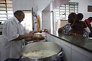The kitchen serving food at Missao Paz, São Paulo, Brazil <br /> <br /> Missao Paz provides advice and support on employment, health, family, community and education. They also have residential quarters where people can stay when they have no where else. <br /> <br /> Their mission is to welcome, understand, integrate and celebrate the lives of immigrants and refugees, dreaming of a universal citizenship.