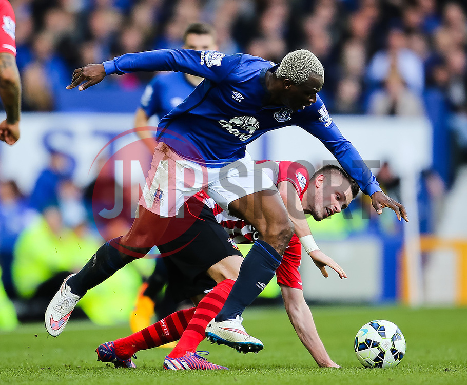 Everton's Arouna Kone bundles over Southampton's Morgan Schneiderlin  - Photo mandatory by-line: Matt McNulty/JMP - Mobile: 07966 386802 - 04/04/2015 - SPORT - Football - Liverpool - Goodison Park - Everton v Southampton - Barclays Premier League
