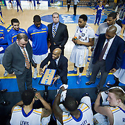 02/01/12 Newark DE: Delaware Men's Head Coach Monté Ross (Center) draws up a play during a time out in the second half a Colonial Athletic Association conference Basketball Game against George Mason Wed, Feb. 1, 2012 at the Bob Carpenter Center in Newark Delaware.