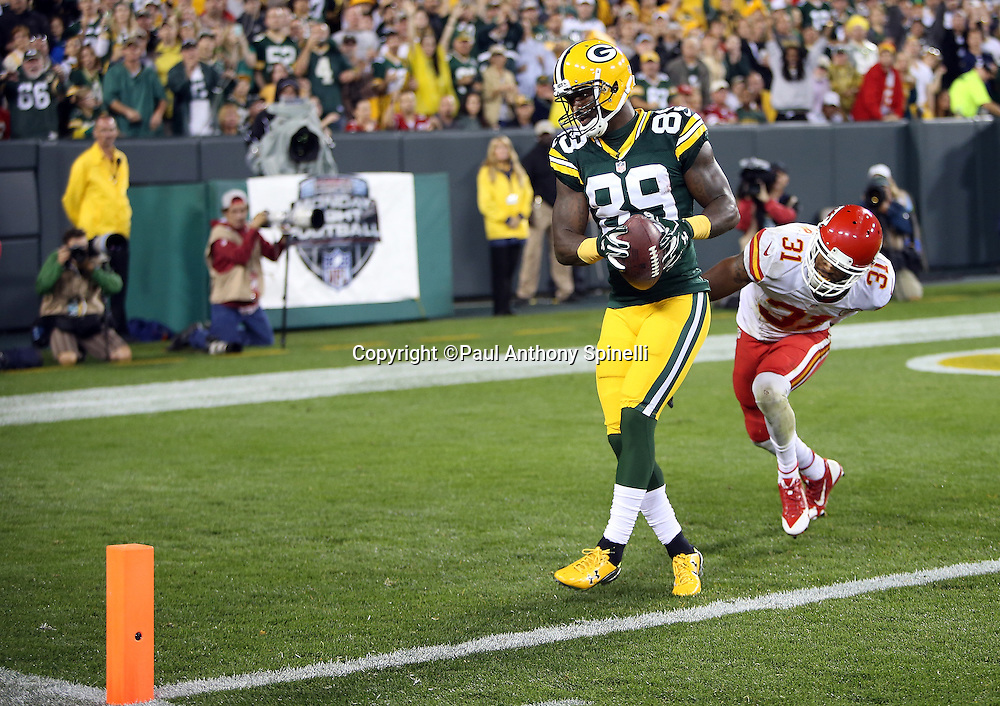 Green Bay Packers wide receiver James Jones (89) catches a 27 yard touchdown pass for a 24-7 late second quarter lead while covered by Kansas City Chiefs cornerback Marcus Cooper (31) during the 2015 NFL week 3 regular season football game against the Kansas City Chiefs on Monday, Sept. 28, 2015 in Green Bay, Wis. The Packers won the game 38-28. (©Paul Anthony Spinelli)