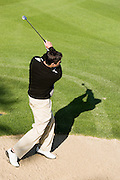 Golfer Watching Shot