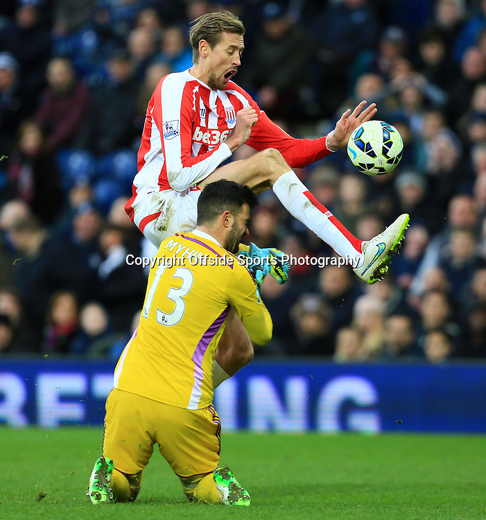 14th March 2015 - Barclays Premier League - West Bromwich Albion v Stoke City - Peter Crouch of Stoke City is fouled by Boaz Myhill of West Bromwich Albion - Photo: Paul Roberts / Offside.