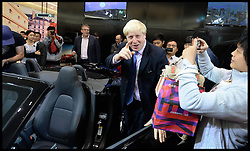 The London Mayor Boris Johnson goes to sit in a Jaguar as he tours around the Great British Brands festival in the Zhuo Zhan Mall in Beijing,  on Day 1 of his 6 day visit to China, Sunday, 13th October 2013. Picture by Andrew Parsons / i-Images