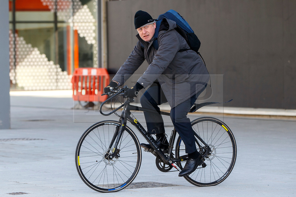 © Licensed to London News Pictures. 14/03/2016. London, UK. Mayor of London Boris Johnson leaves Here East, the former press and broadcast centre in the Queen Elizabeth Olympic Park in London after kick starting National Apprenticeship Week on Monday, 14 March 2016. Photo credit: Tolga Akmen/LNP