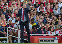 Football - 2019 / 2020 Premier League - Arsenal vs. Tottenham Hotspur<br /> <br /> Unai Emery, manager of Arsenal FC, gets his message across the field at The Emirates.<br /> <br /> COLORSPORT/DANIEL BEARHAM