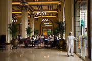 Guests enjoy high tea at the Peninsula Hotel, Hong Kong, China