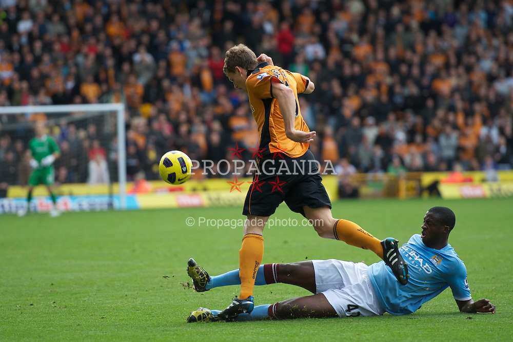 WOLVERHAMPTON, ENGLAND - Saturday, October 30, 2010: Manchester City's Yaya Toure tackles Wolverhampton Wanderers' Christophe Berra during the Premiership match at Molineux. (Pic by: David Rawcliffe/Propaganda)