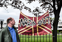 Anti-fascists gather to protest against a march held by the English Defence League. May 2015 Walthamstow London