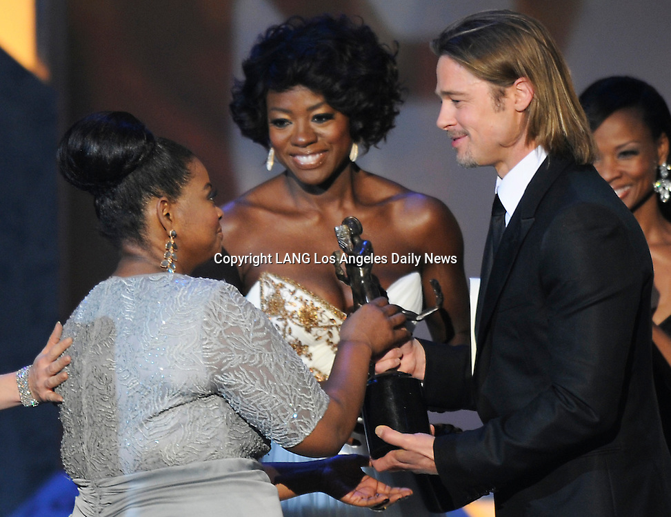 "The cast of ""The Help"" receives the Actor from Brad Pitt after winning Cast In a Theatrical Motion Picture. The 18th Annual Screen Actors Guild Awards were held at the Shrine Exposition Center in Los Angeles, CA 1/29/2012(John McCoy/Staff Photographer)"