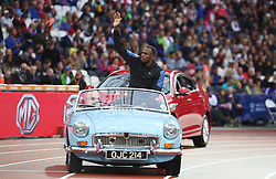© Licensed to London News Pictures. 24/07/2015. London, UK. Jamaican sprinter Usain Bolt arrives in a vintage car at the Diamond League at the Olympic Stadium as part of the Sainsbury's Anniversary Games. Photo credit: LNP