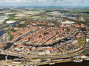 Nederland, Friesland, Harlingen, 16-04-2012; overzicht van het centrum van de stad. Foto richting Franeker, Leeuwarden aan de verre horizon..View on the city of Harlingen and surroundings. .luchtfoto (toeslag), aerial photo (additional fee required);.copyright foto/photo Siebe Swart