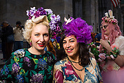 New York, NY - 21 April 2019. Two women in floral dresses and colorful fascinators at the Easter Bonnet Parade and Festival on New York's Fifth Avenue.
