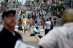 Pedestrians, cyclist, skaters, joggers enjoy a closed off 4mi (6.4km) section of North Broad Street, in Philadelphia, PA, during the third annual Philly Free Streets event on August 11, 2018.