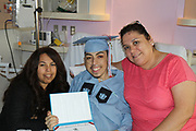 Madison HS senior Erick Reyes with his mother, Maria Reyes, and his aunt, Rosalba Reyes, after receiving his high school diploma at Texas Children's Hospital.
