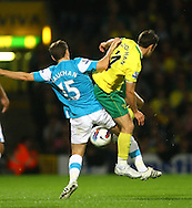 Picture by Paul Chesterton/Focus Images Ltd.  07904 640267.26/9/11.Wes Hoolahan of Norwich and David Vaughan of Sunderland in action during the Barclays Premier League match at Carrow Road stadium, Norwich.
