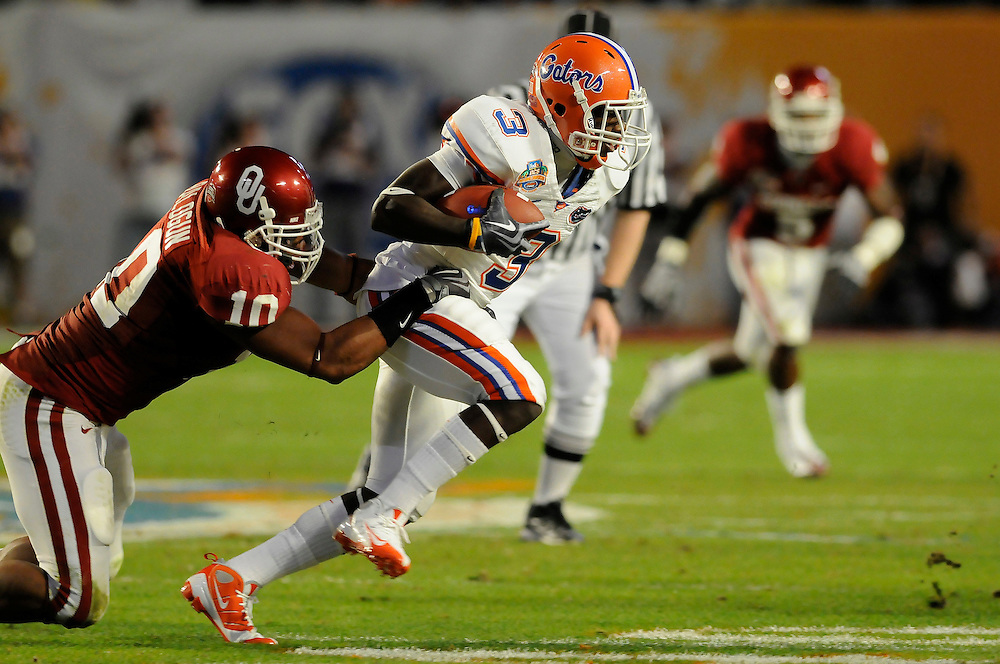 January 8, 2009: Mike Balogun of the Oklahoma Sooners tackles Chris Rainey of the Florida Gators during the NCAA football game between the Florida Gators and the Oklahoma Sooners in the 2009 BCS National Championship Game. The Gators defeated the Sooners 24-14.