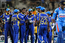 © Licensed to London News Pictures. 14/02/2012. Adelaide Oval, Australia. The Sri Lankans come together after getting the wicket of Irfan Pathan during the One Day International cricket match between India Vs Sri Lanka. Photo credit : Asanka Brendon Ratnayake/LNP