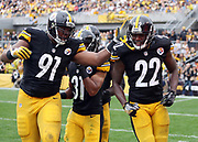 Pittsburgh Steelers cornerback William Gay (22) celebrates with Pittsburgh Steelers defensive end Stephon Tuitt (91) and Pittsburgh Steelers cornerback Ross Cockrell (31) after Gay makes a hit that stuffs a Cincinnati Bengals third down play forcing a punt deep in Bengals territory during the 2016 NFL week 2 regular season football game against the Cincinnati Bengals on Sunday, Sept. 18, 2016 in Pittsburgh. The Steelers won the game 24-16. (©Paul Anthony Spinelli)