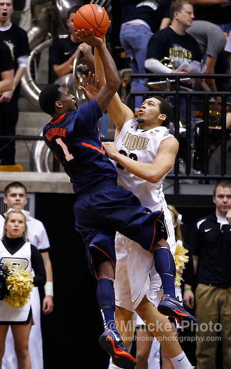 WEST LAFAYETTE, IN - JANUARY 02: D.J. Richardson #1 of the Illinois Fighting Illini shoots against A.J. Hammons #20 of the Purdue Boilermakers at Mackey Arena on January 2, 2013 in West Lafayette, Indiana. Purdue defeated Illinois 68-61. (Photo by Michael Hickey/Getty Images) *** Local Caption *** D.J. Richardson;  A.J. Hammons