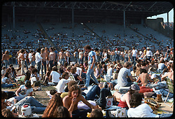 The crowd, deadheads, and the venue before the Grateful Dead Concert begins at Roosevelt Stadium 4 August 1976. View probably not far from home plate, facing northwest.