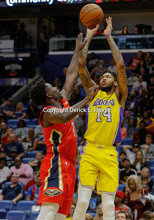 Feb 14, 2018; New Orleans, LA, USA; Los Angeles Lakers forward Brandon Ingram (14) shoots over New Orleans Pelicans guard Jrue Holiday (11) during the first quarter at the Smoothie King Center. Mandatory Credit: Derick E. Hingle-USA TODAY Sports