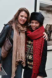 ANNABEL CROFT and her daughter AMBER COLEMAN at a private view of photographs by wildlife photographer David Yarrow included in his book 'Encounter' held at The Saatchi Gallery, Duke of York's HQ, King's Road, London on 13th November 2013.