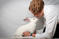 """JEROME A. POLLOS/Press..Carolyn Westrick, 13, has been showing rabbits for market for the past three years and won a grand champion award this year with her 2-month-old Californian named Buck. """"It's really fun to walk in and see all the new bunnies after their born,"""" Westrick said about why she enjoys showing rabbits. """"They're just so cute and really sweet animals."""