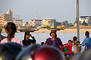 Phnom Penh, Cambodia. Evening rush hour seen from aboard a Tuk Tuk. Tonle Sap.