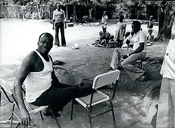 Dec. 16, 1965 - General Mustafa Adrisi, the no. 2 man of Idi Amin and the most feared man after Amin in Uganda. He is now living in exile in Southern Sudan with his three wives and 36 children. Adrisi said he still regards himself as Vice President of Uganda. Seated here in the ground of a house in Yei with some members of his family in background. (Credit Image: © Keystone Pictures USA/ZUMAPRESS.com)