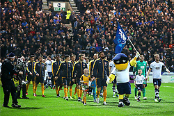 Arsenal and Preston North End players walk out with the club mascot - Mandatory by-line: Matt McNulty/JMP - 07/01/2017 - FOOTBALL - Deepdale - Preston, England - Preston North End v Arsenal - Emirates FA Cup third round