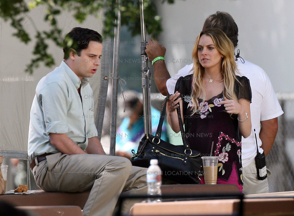 LOS ANGELES, CALIFORNIA - THURSDAY 12TH JUNE 2008 NON EXCLUSIVE: Lindsay Lohan is back to work on her latest movie 'Labor Pains'. Lohan filmed a kissing scene with co-star Luke Kirby on a picnic bench in a local park. Photograph: On Location News. Sales: Eric Ford 1/818-613-3955 info@OnLocationNews.com