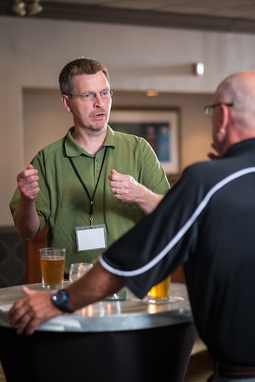 Aaron Wright, left, chats with Scott Smith at the end of the Master of Athletics Administration opening reception in the Ohio University Inn on Thursday, June 25, 2015.  © Ohio University / Photo by Rob Hardin