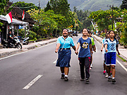 07 AUGUST 2017 - MANGGIS, BALI, INDONESIA: Girls from a local high school rehearse their Indonesian Independence Day parade in Manggis, an ocean side community in eastern Bali. Indonesian Independence Day, the country's national holiday, is celebrated on August 17. It was on that date in 1945 that Sukarno signed Indonesia's proclamation of independence from the Netherlands. It was the beginning of a four year war for independence. The Dutch didn't officially grant Indonesia independence until December, 1949. The day is celebrated with parades and enthusiastic displays of patriotism throughout the country.    PHOTO BY JACK KURTZ
